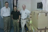 Ian Roberts-Thompson, Daniel Worthley, and Tony Clark with the donation shipment at the WGO Suva Training Center.