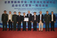 Training Center Director, Prof. Kaichun Wu; then WGO President, Prof. James Toouli; then WGO Vice President, Prof. KL Goh; and Chair of the WGO Scientific Programs Committee and President of Xijing Hospital of Digestive Diseases, Prof. Daiming Fan; with faculty at the WGO-Xijing Training Center